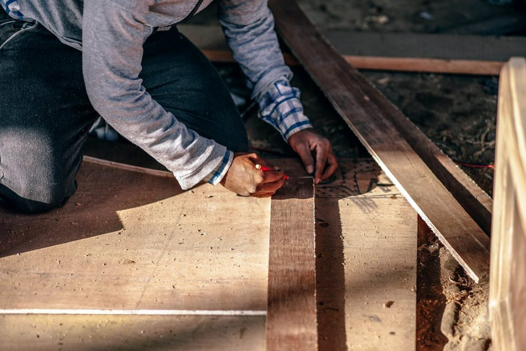 Man measuring wood - The Property Blog