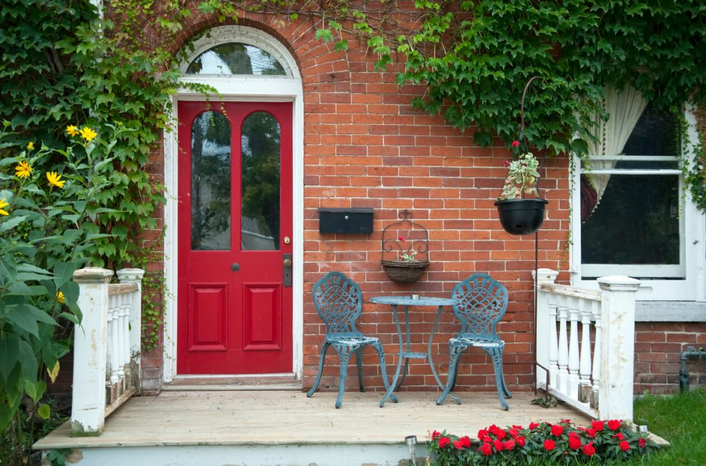 front door with chairs - The Property Blog