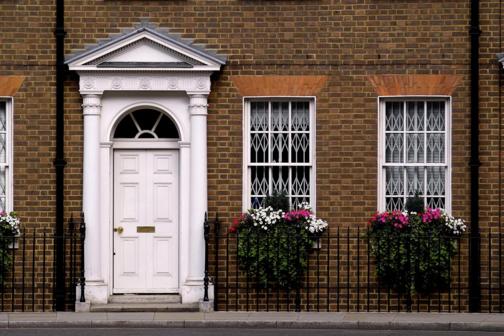 front door with hanging baskets - The Property Blog